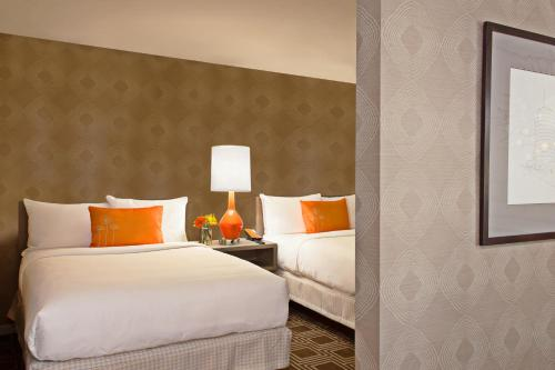 A bed or beds in a room at The Garland