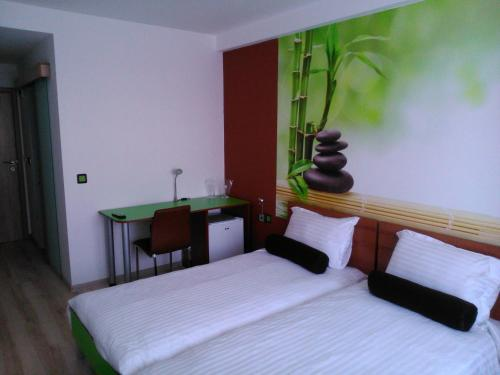 A bed or beds in a room at Hotel GabriSa
