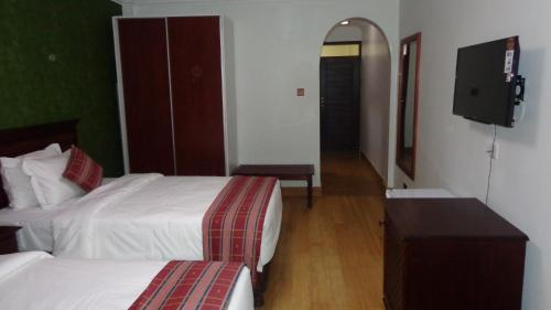 A bed or beds in a room at Eagle Palace Hotel