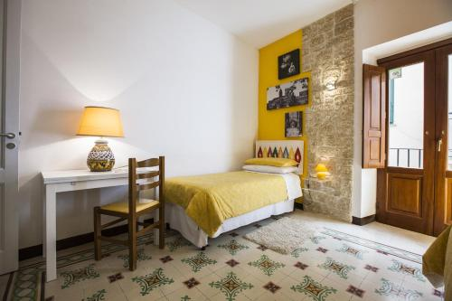 Letto o letti in una camera di Antico Borgo
