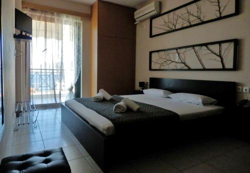 Ένα ή περισσότερα κρεβάτια σε δωμάτιο στο Sagini Boutique Hotel