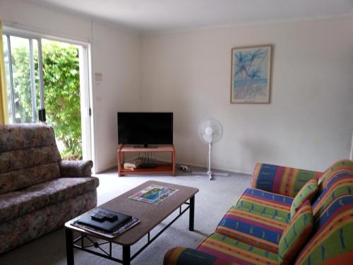 A seating area at Sandy Court Holiday Units