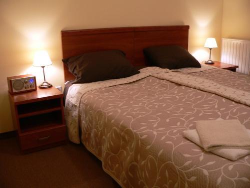 Łóżko lub łóżka w pokoju w obiekcie Pensjonat Lira