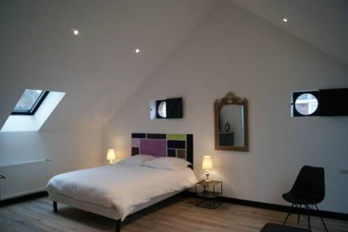 Un ou plusieurs lits dans un hébergement de l'établissement La Grange De Salomé