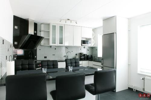 Ett kök eller pentry på Serviced Apartments Malmö