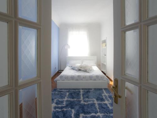 Cama o camas de una habitación en A Casa di Sara