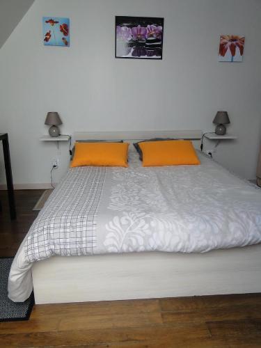 Un ou plusieurs lits dans un hébergement de l'établissement Studio Dadi