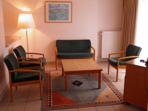 Ein Sitzbereich in der Unterkunft Domein Westhoek Apartment