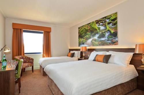 A bed or beds in a room at Nox Hotel Galway