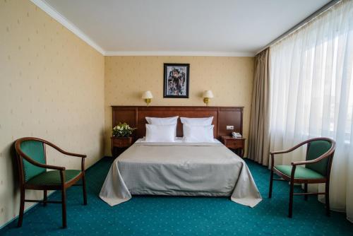 Кровать или кровати в номере Историческая Гостиница Калуга