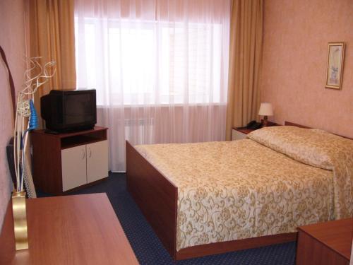 Кровать или кровати в номере Гостиница Зори
