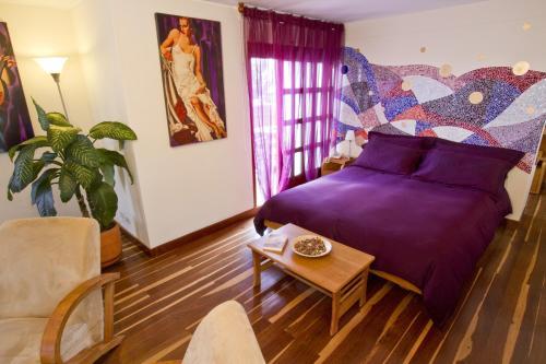 Un ou plusieurs lits dans un hébergement de l'établissement Hotel Casa Deco