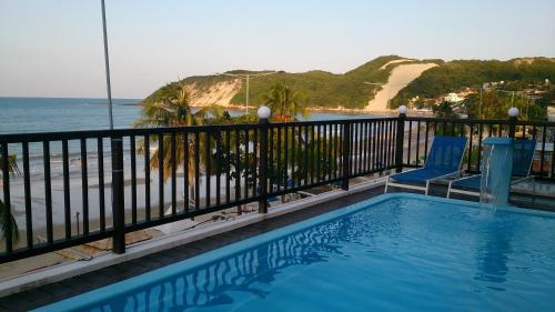 A piscina localizada em Hotel Pousada Azzurra ou nos arredores