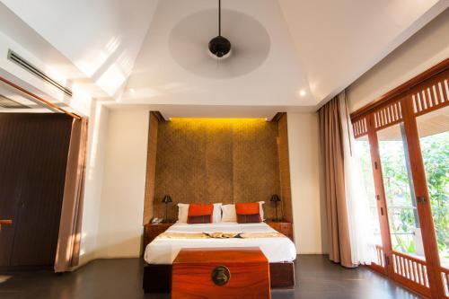 A bed or beds in a room at GUTI Resort by AKA Hua Hin