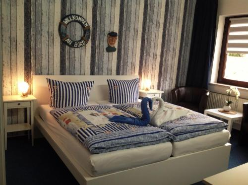A bed or beds in a room at Haus an der Uffe