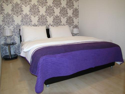 A bed or beds in a room at Apartments Marina