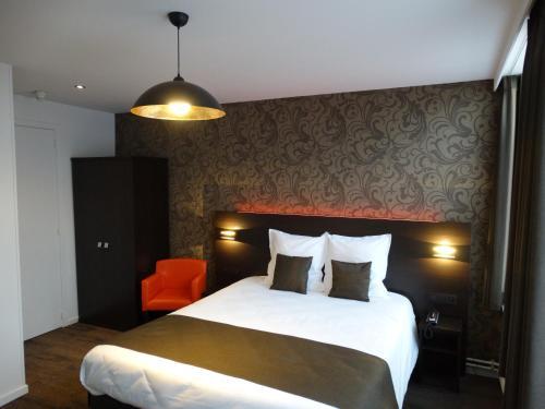 Un ou plusieurs lits dans un hébergement de l'établissement Hotel Kristoffel