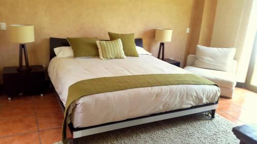 Hotel Boutique Casa Santa Inesにあるベッド