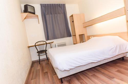 Кровать или кровати в номере Hotel De La Basse Sambre