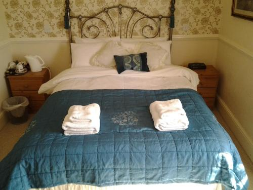 A bed or beds in a room at No. 9 Guest House
