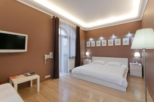 Кровать или кровати в номере SweetHotel Vnukovo