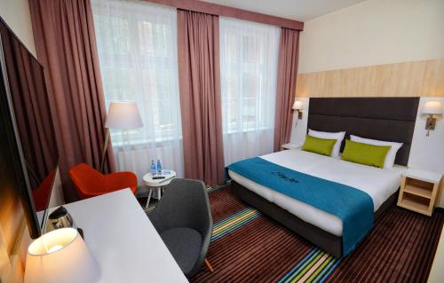 A bed or beds in a room at Stay Inn Hotel