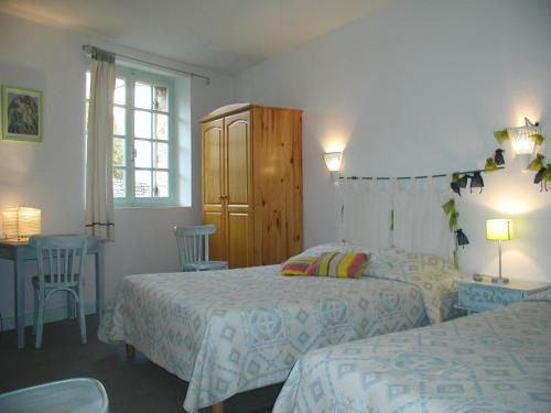 Un ou plusieurs lits dans un hébergement de l'établissement Le Chambellan