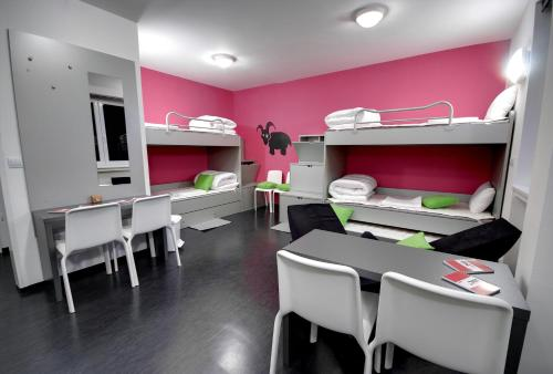 A bunk bed or bunk beds in a room at MC Hostel Brezice