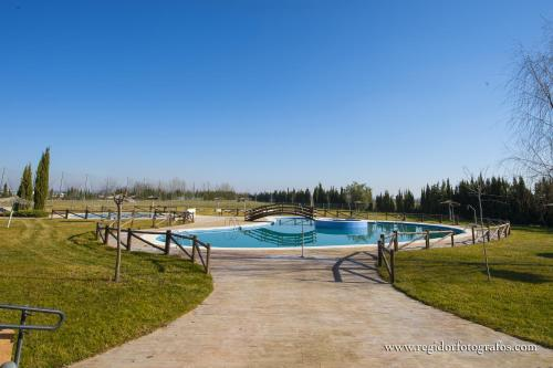 The swimming pool at or near Hospedium Hotel Cortijo Santa Cruz