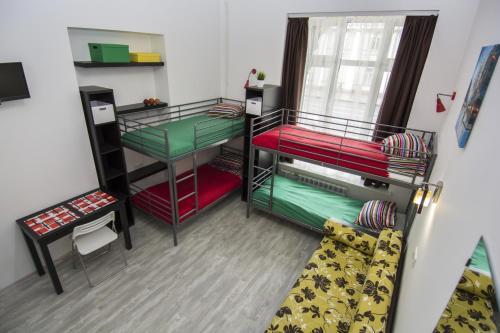 A bunk bed or bunk beds in a room at KLUKVA на Невском