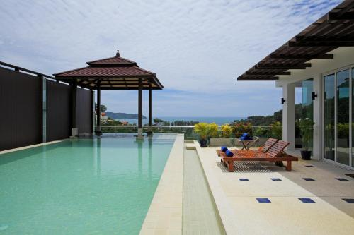 The swimming pool at or near Luxury Seaview Penthouse Kamala Beach