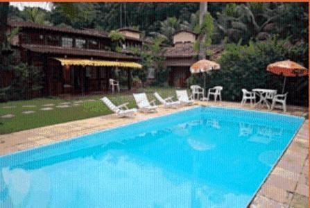 The swimming pool at or near Pousada Antígona