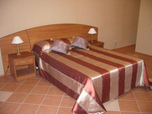 Кровать или кровати в номере Отель Маяк