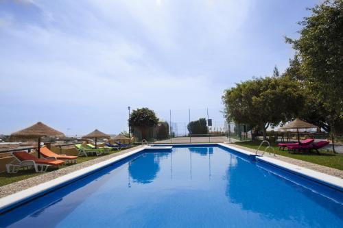 The swimming pool at or close to Cortijo Amaya