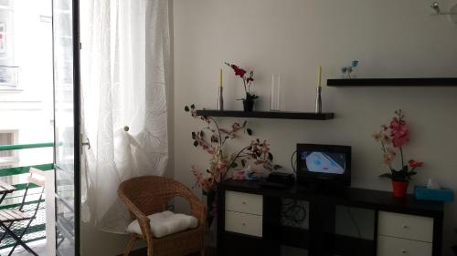 A television and/or entertainment center at Apartment Louvre
