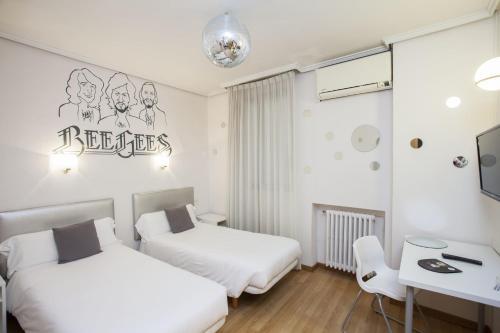 Casual de la Música Valenciaにあるベッド
