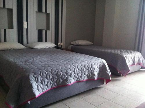 A bed or beds in a room at Elektra Hotel