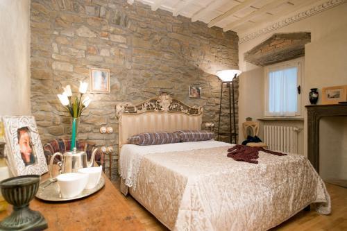 Letto o letti in una camera di Casa Sofia