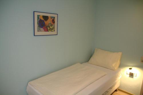 Ein Bett oder Betten in einem Zimmer der Unterkunft Hotel Lu
