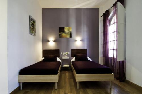 A bed or beds in a room at Un Patio en Santa Cruz