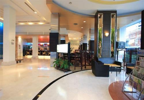 The lobby or reception area at Golden Crown Grand Hotel