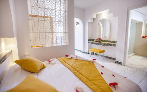 A bed or beds in a room at Seabel Aladin Djerba