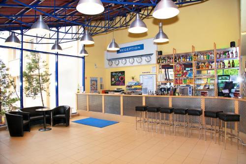 The lounge or bar area at a&o Prague Metro Strizkov
