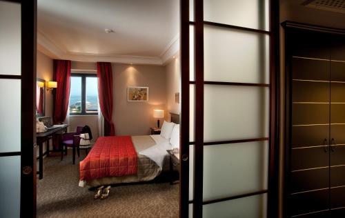 Letto o letti in una camera di Hotel Regina Margherita