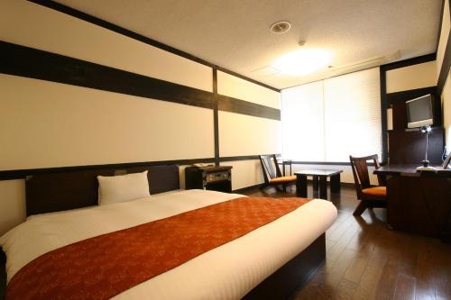 A bed or beds in a room at Wasuki Tsukasakan