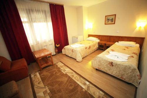A bed or beds in a room at Family Hotel Bansko Sofia