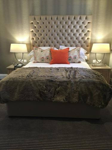 A bed or beds in a room at Moxhull Hall