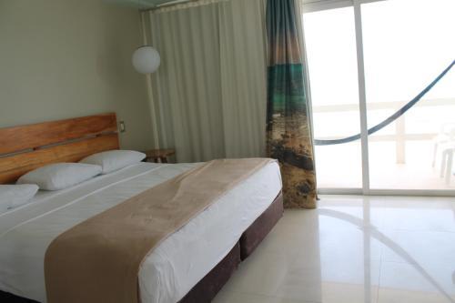 Un ou plusieurs lits dans un hébergement de l'établissement Rocamar Hotel Isla Mujeres