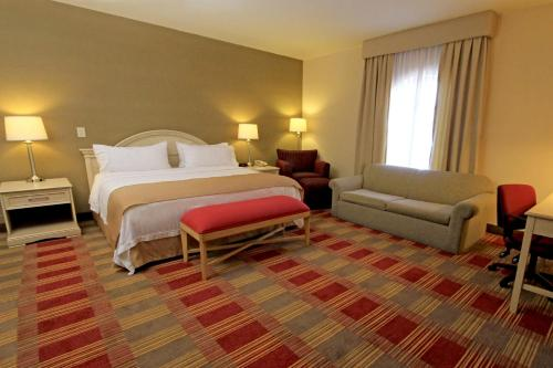 A bed or beds in a room at Holiday Inn Monclova, an IHG Hotel