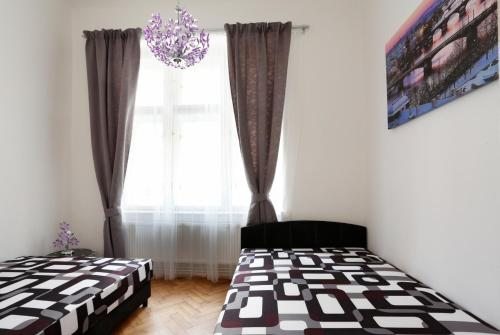 A bed or beds in a room at Apartment Pštrossova